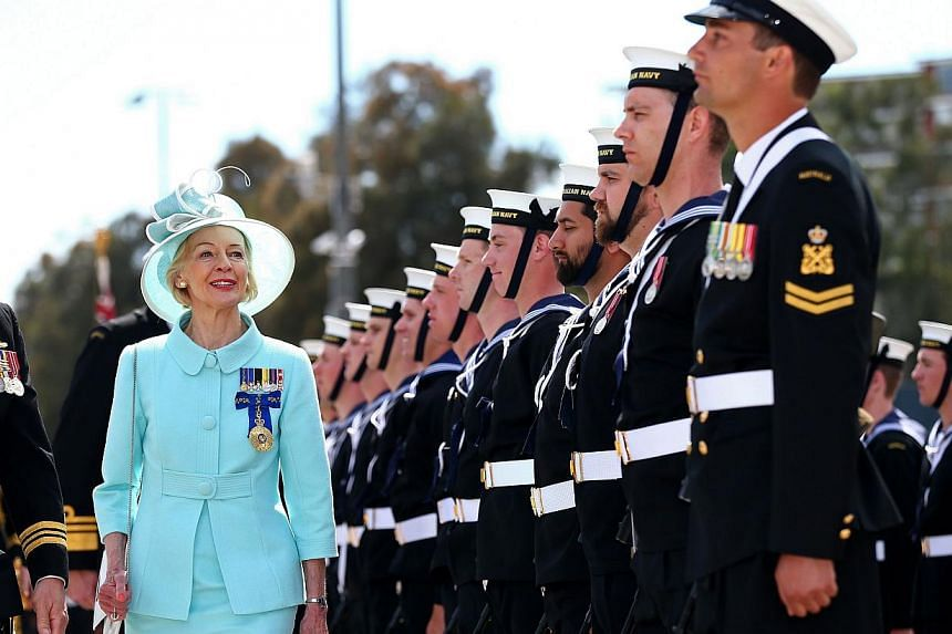 Australia's Governor-General Quentin Bryce (second left) is greeted by the Royal Australian Navy as she arrives at Garden Island in Sydney to attend the 2013 International Fleet Review on Oct 5, 2013. -- PHOTO: AFP