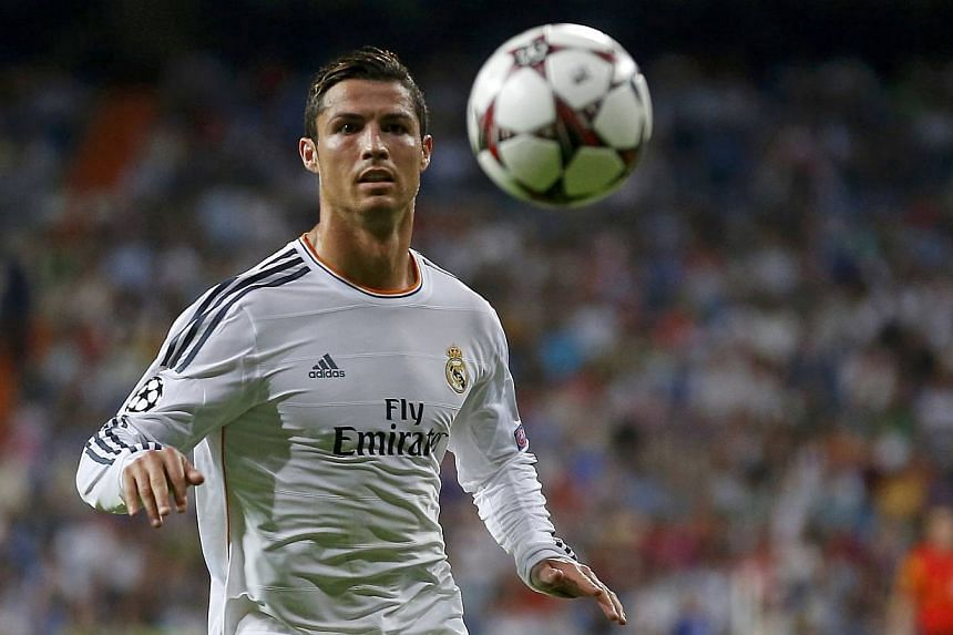 Real Madrid's Cristiano Ronaldo controls a ball during the soccer match against FC Copenhagen for the Champions League at Bernabeu stadium in Madrid on Oct 2, 2013. Ronaldo is appealing to Florida officials to drop charges against an over-enthusiasti