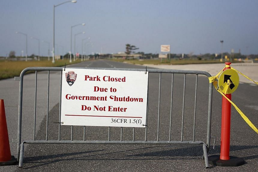 """A sign at the entrance of the Jacob Riis Park in the borough of Queens is seen in New York on Friday, Oct 4, 2013. Saying the United States government shutdown was having a """"heartbreaking"""" impact on ordinary Americans, President Barack Obama on Satur"""