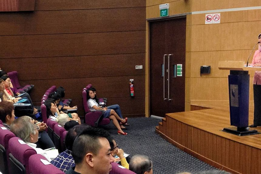 Madam Halimah Yacob shares her views on work and family life balance with about 200 members of the public at the 7th Children's Society Lecture on Oct 5, 2013. The Speaker of Parliament has urged the Government to legislate for family or elder c