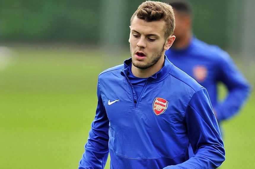 Arsenal's English midfielder Jack Wilshere attends a team training session for the forthcoming UEFA Champions League Group F football match against SSC Napoli at Arsenal's London Colney training ground in north London on September 30, 2013.Engl