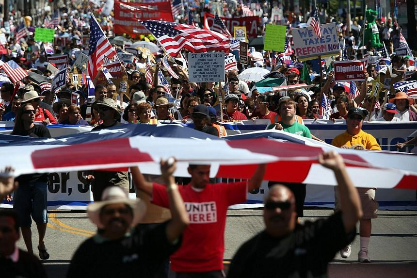 Immigration advocates take part in a National Day of Dignity and Respect march on October 5, 2013 in Los Angeles, California. Thousands of people marched for comprehensive immigration reform in more than 150 events nationwide. Thousands of people pou