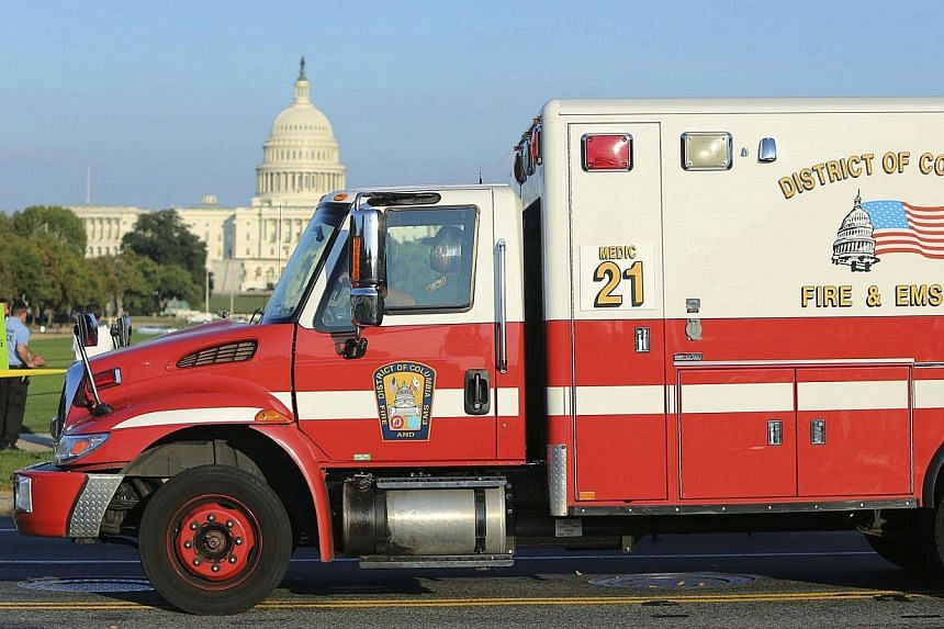A Washington, DC ambulance leaves the scene where a man set himself on fire near the US Capitol building on the National Mall in Washington, on Oct 4, 2013. A man who set himself on fire on the National Mall in the US capital has died, police s