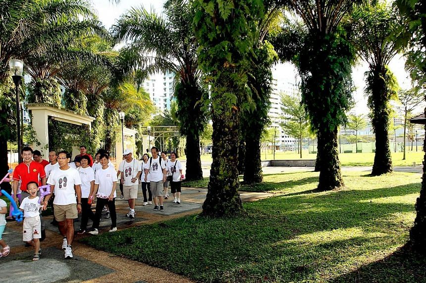 MP for Nee Soon GRC Lim Wee Kiak (in red) walking with residents on Sunday morning, Oct 6, 2013, as he launched the groundbreaking ceremony of the new Canberra Park. Canberra Park will receive a $2 million boost to transform it into a recreation