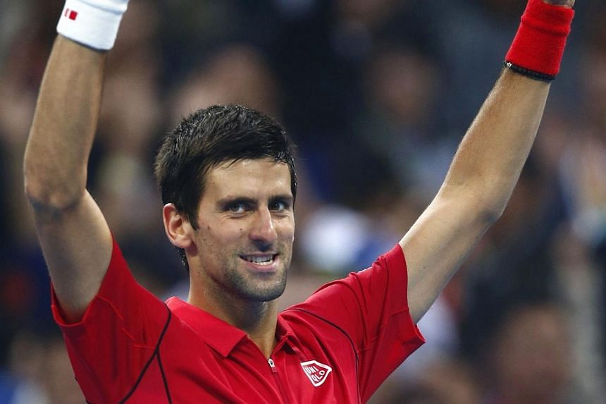Novak Djokovic (above) of Serbia celebrates after winning his men's singles final match against Rafael Nadal of Spain at the China Open tennis tournament in Beijing on Sunday, Oct 6, 2013.Djokovic overcame Nadal in straight sets on Sunday to wi