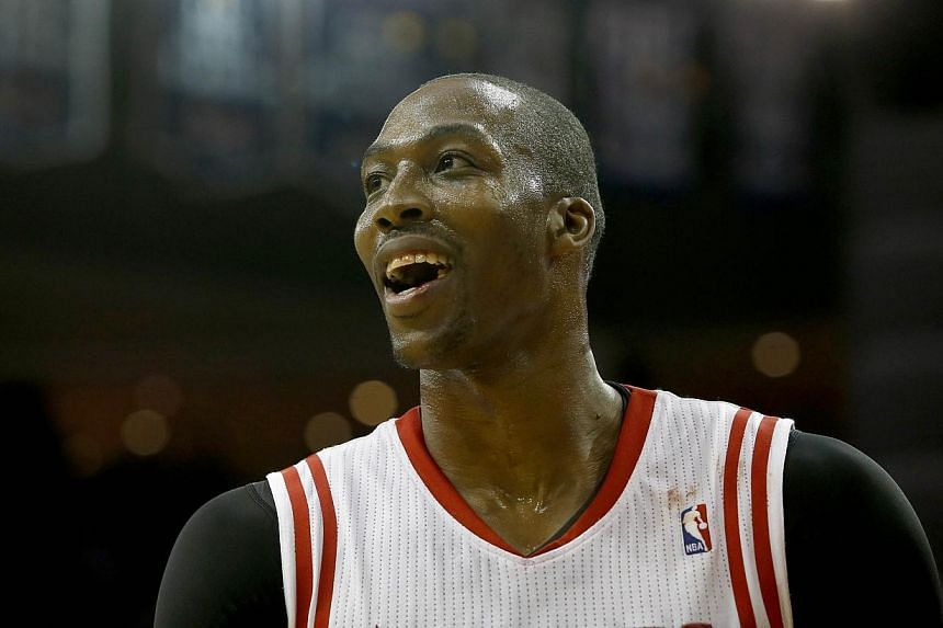 Houston Rockets centre Dwight Howardsmiles after he was called for a foul during action against the New Orleans Pelicans in a preseason NBA game on Oct 5, 2013 at Toyota Center in Houston, Texas.Howard responded to Hall of Famer Kareem Ab