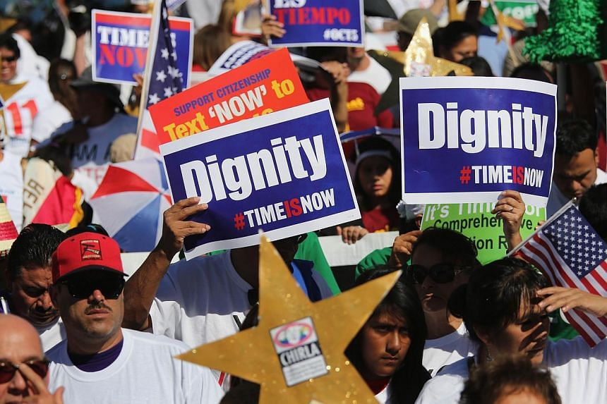Immigration advocates gather for a National Day of Dignity and Respect march on Oct 5, 2013 in Los Angeles, California. Thousands of people poured into streets across the United States on Saturday in a push to overhaul immigration and end the l