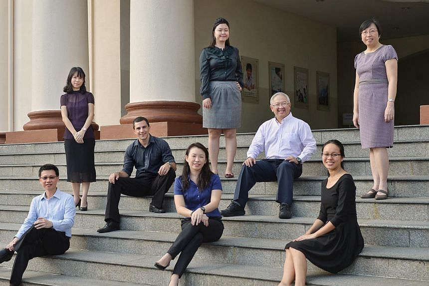 Hwa Chong Institution teachers, (from left) Dr Melvyn Lim, Ms Veronica Yap, Dr Nicholas Richard Mercer, Dr Audrey Cheong, Ms Liew Pei Li, Dr Hon Chiew Weng, Dr Sandra Tan and Dr Har-Chia Hui Peng, all hold either master's degrees or doctorates. Aroun