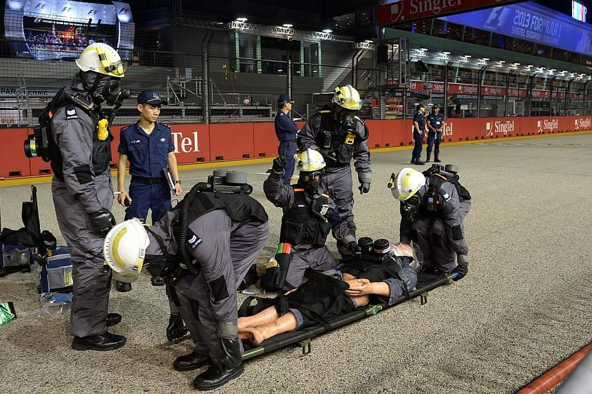 The SCDF carrying out an emergency evacuation drill at the Singapore Grand Prix. Its Hazmat unit has issued a tender for a prototype system - essentially a conveyor belt for humans - to deploy, for instance, in a mass-casualties incident.