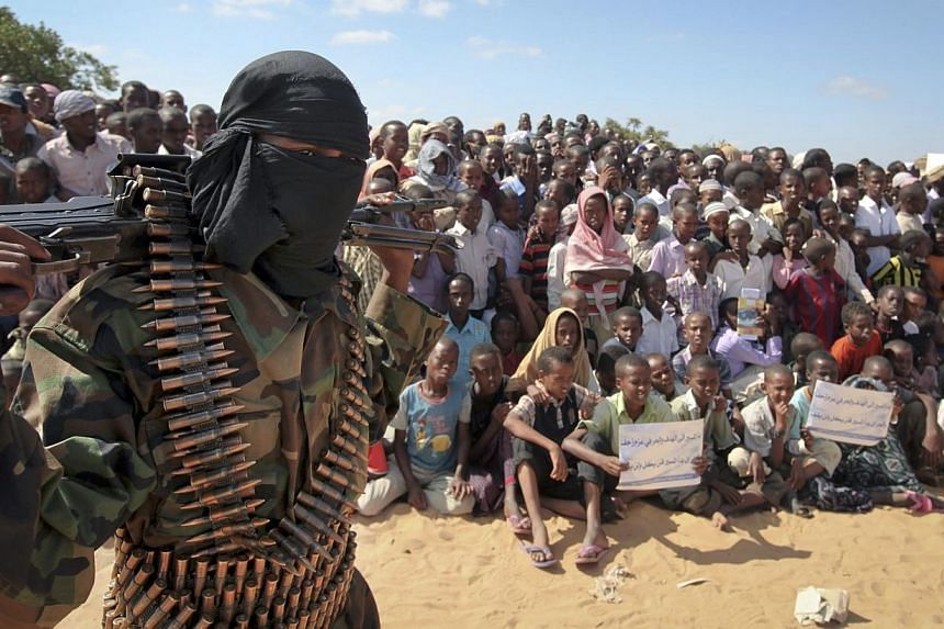 An armed member of the militant group al-Shabab attends a rally on the outskirts of Mogadishu, Somalia on Feb 13, 2013. -- FILE PHOTO: AP
