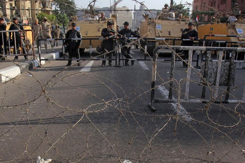 Egyptian soldiers backed by armoured personnel carriers block an entrance to Tahrir Square in Cairo, Saturday, Oct 5, 2013 a day ahead of expected mass demonstrations by supporters of ousted Islamist President Mohamed Mursi timed to coincide with ann