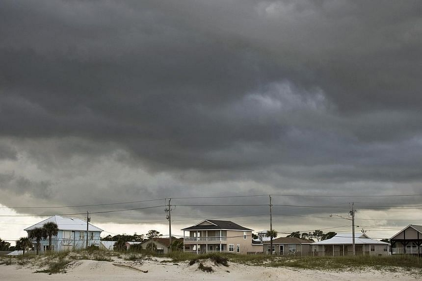 Storm clouds roll in from the Gulf of Mexico in Gulf Shores, Alabama, as weakening Tropical Storm Karen approaches landfall Oct 5, 2013. -- PHOTO: REUTERS