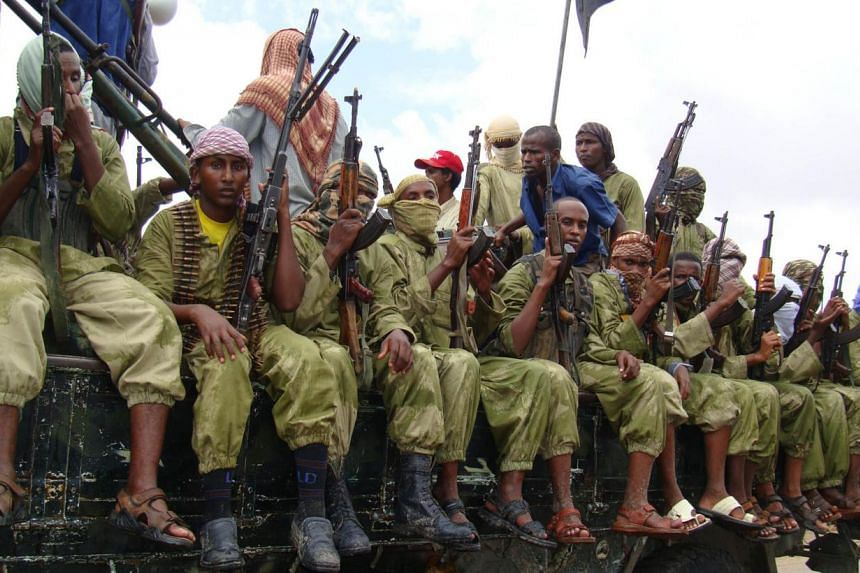 """In this Oct 30, 2009 file photo, Al-Shabab fighters sit on a truck as they patrol in Mogadishu, Somalia.Somalian Islamist militants Al-Shabaab said on Sunday there was """"no senior official"""" present at a house raided by US forces south of t"""