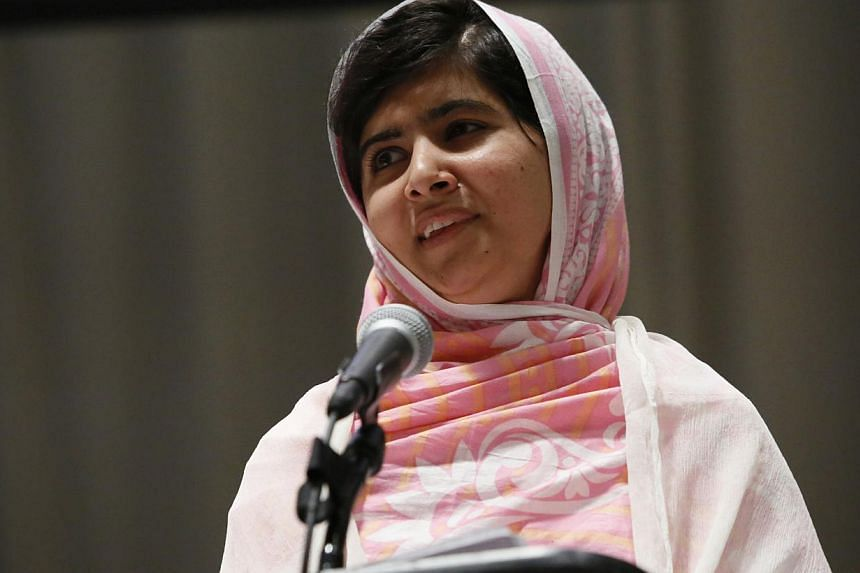 In this Friday, July 12, 2013 file photo provided by the United Nations Foundation, Malala Yousafzai celebrates her 16th birthday by addressing hundreds of young leaders who support the United Nation's Secretary General's Global Education First Ini