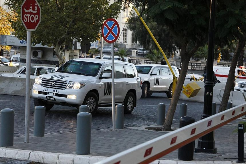 U.N. vehicles transporting a team of experts from the Organization for the Prohibition of Chemical Weapons (OPCW) return to their hotel in Damascus October 6, 2013.Experts destroyed missile warheads, aerial bombs and chemical mixing equipment S