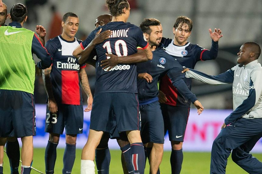 Paris Saint-Germain's players celebrate after the French L1 football match Olympique de Marseille (OM) vs Paris Saint-Germain (PSG) on October 6, 2013 at the Velodrome stadium in Marseille, southern FranceParis Saint-Germain hit back from a goal down