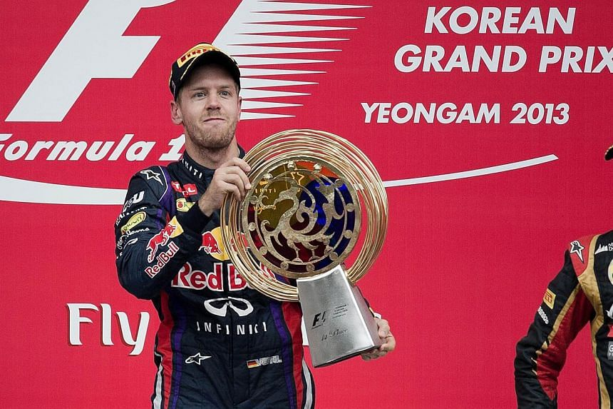 Red Bull driver Sebastian Vettel of Germany celebrates after winning the Formula One Korean Grand Prix in Yeongam on October 6, 2013.Sebastian Vettel jets off to one of his favourite circuits knowing he can seal a fourth world title in su