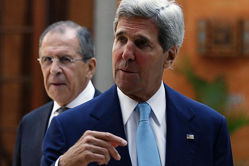 Russia's Foreign Minister Sergey Lavrov (left) and U.S. Secretary of State John Kerry attend a bilateral meeting on the sidelines of the Asia-Pacific Economic Cooperation (APEC) Summit in Nusa Dua on the Indonesian resort island of Bali, Oct 7, 2013.