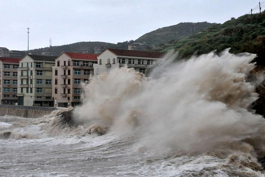 Huge waves hit the dike as Typhoon Fitow moves to make its landfall in Wenling, east China's Zhejiang province on Sunday, Oct 6, 2013.Typhoon Fitow barrelled into China's east coast on Monday, Oct 7, 2013, packing winds of more than 200km per h