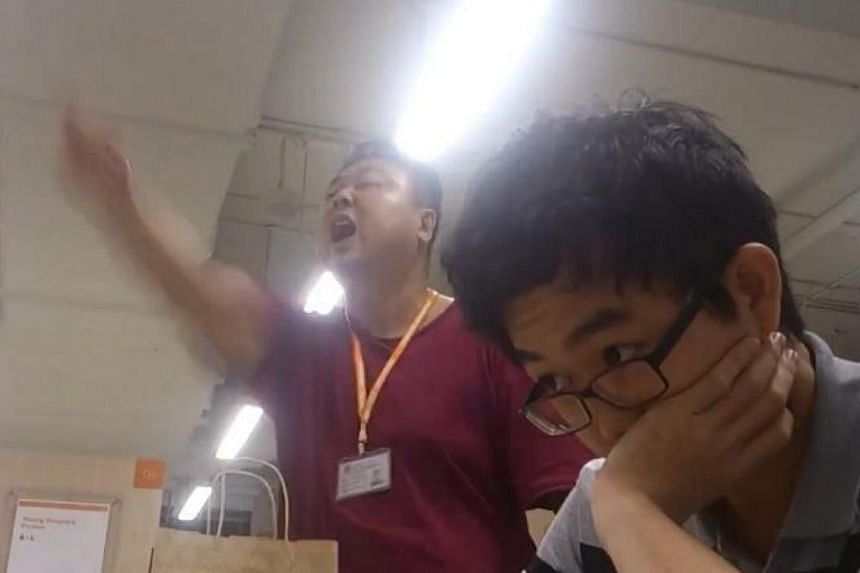 """The Ministry of Defence (Mindef) has clarified that the man who was filmed shouting in a library and claiming to be """"Singapore Armed Forces commando special operations force counter terrorist plainclothes"""" is not a member of the SAF. --PHOTO: S"""