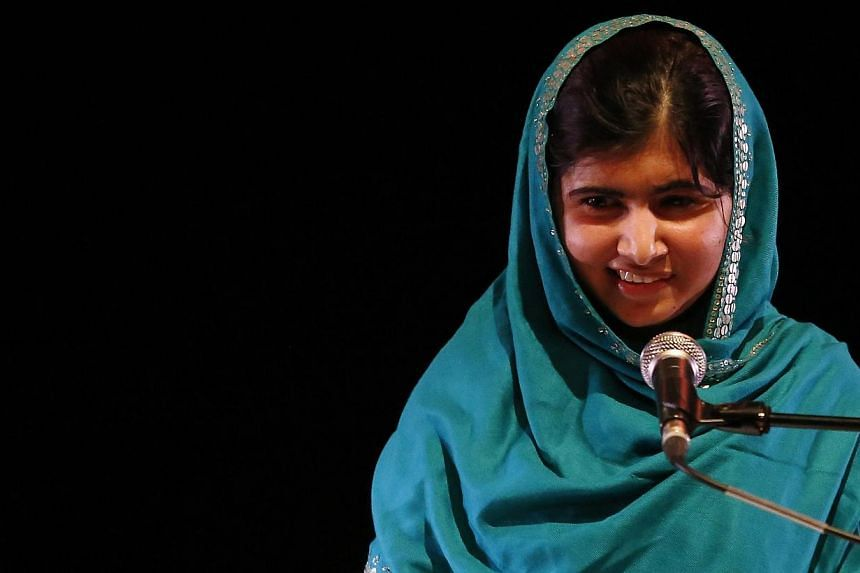 Pakistan's Malala Yousafzai gives a speech after receiving the RAW (Reach All Women) in War Anna Politkovskaya Award at the Southbank Centre in London on Oct 4, 2013. Malalasaid on Monday, Oct 7, 2013, she hoped to become a politician to change