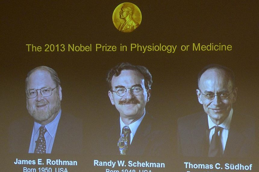 A screen displays photos of (from left) Professor James E Rothman from the US, ProfessorRandy W Schekman from the US and Dr Thomas C Suedhof from Germany, all joined winners of the Medicine Nobel Prize, at a press conference to announce the lau