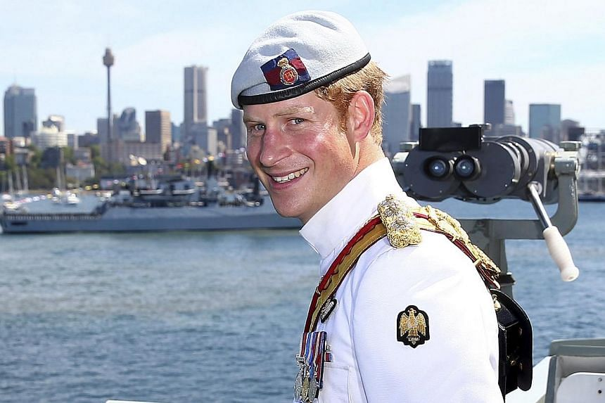 Britain's Prince Harry smiles while onboard the HMAS Leeuwin as the ship participates in the 2013 International Fleet Review in Sydney, Australia Saturday, Oct 5, 2013. -- FILE PHOTO: AP