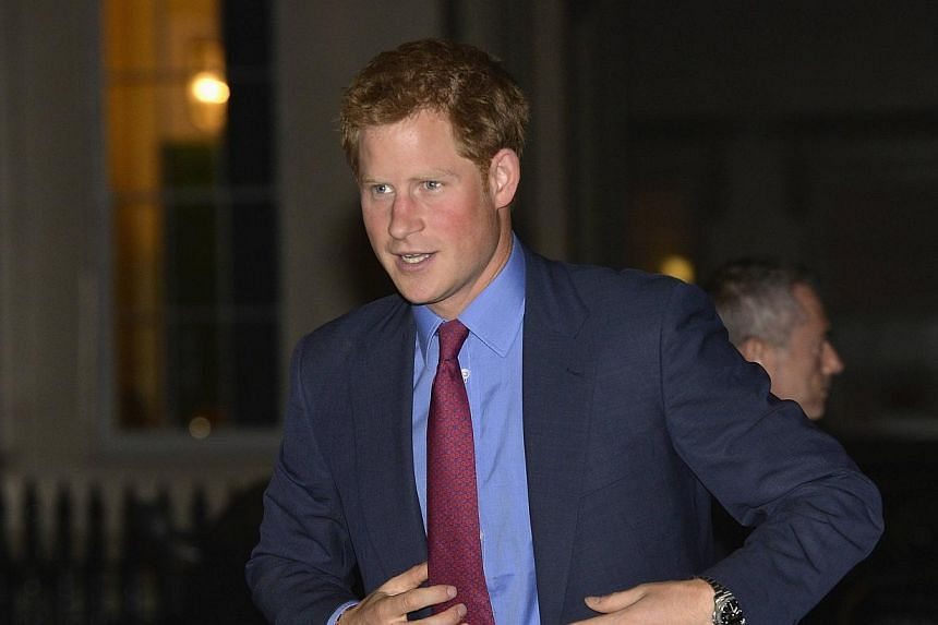 Britain's Prince Harry arrives to attend an evening reception for MapAction at the Royal Society in central London, Sept 26, 2013. -- FILE PHOTO: REUTERS