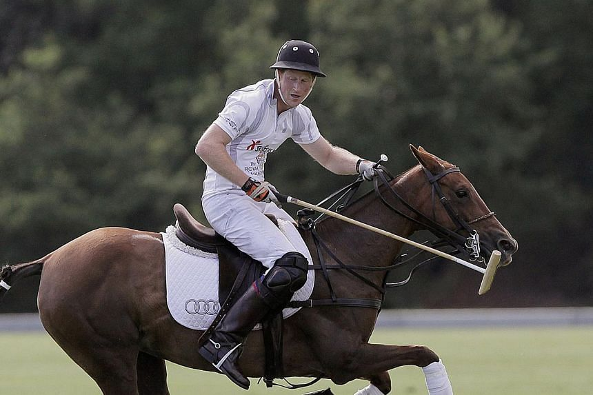 Britain's Prince Harry plays in a charity polo match at Coworth Park, Near Ascot, Berkshire on Aug 3, 2013. -- FILE PHOTO: AFP