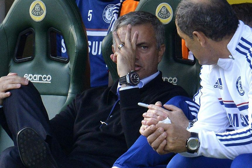 Chelsea's manager Jose Mourinho gestures after his team scored a third goal during their English Premier League soccer match against Norwich City at Carrow Road in Norwich, Oct 6, 2013. -- PHOTO: REUTERS