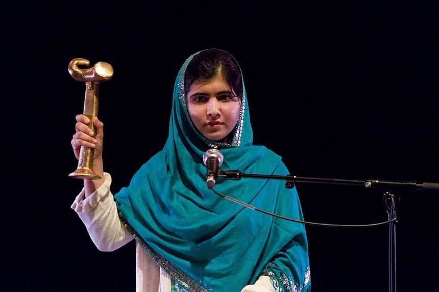 "Malala Yousafzai gives a speech after receiving the RAW in WAR Anna Politkovskaya Award at the Southbank Centre in central London on Oct 4, 2013. The Pakistani Taleban on Monday said Malala Yousafzai had ""no courage"" and vowed to attack her agai"