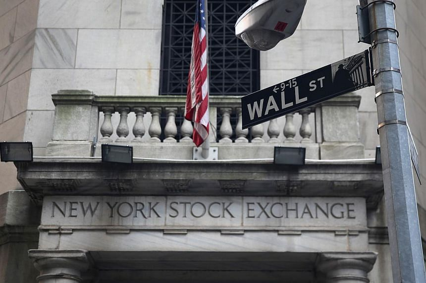 The New York Stock Exchange stands on Wall Street on Aug 27, 2013 in New York City.US stocks on Monday finished lower as a partial US government shutdown entered its second week with no sign of resolution. -- FILE PHOTO: AFP