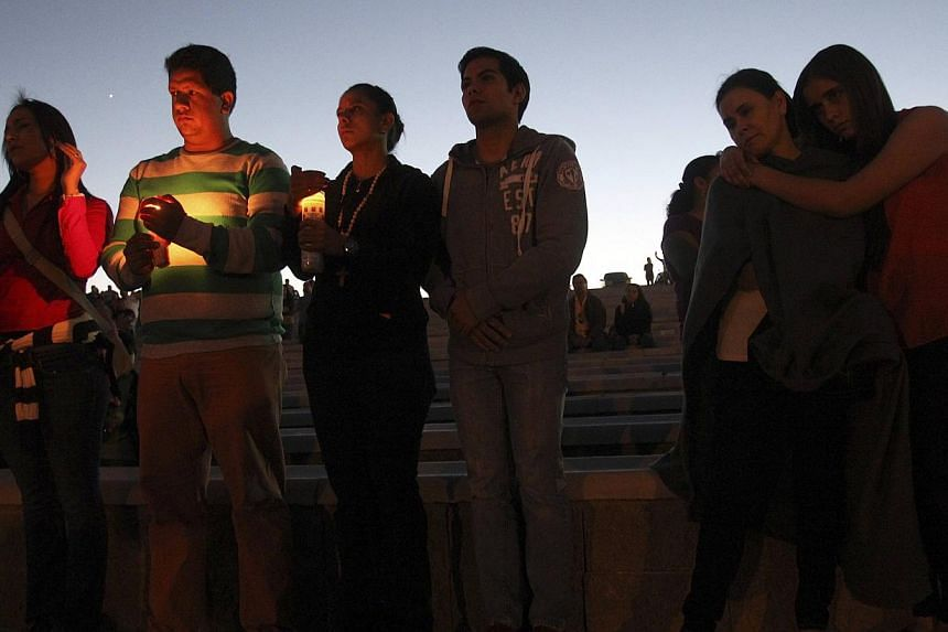 Relatives and friends attend a candlelight vigil for the victims of a monster truck that ploughed into a crowd of spectators during a show at El Rejon park, on the outskirts of Chihuahua, on Oct 6, 2013. Chihuahua governor Cesar Duarte on Oct 7 said
