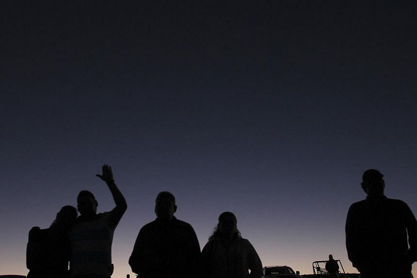 Relatives and friends pray during a candlelight vigil for the victims of a monster truck that ploughed into a crowd of spectators during a show at El Rejon park, on the outskirts of Chihuahua, on Oct 6, 2013. Chihuahua governor Cesar Duarte said the