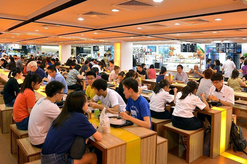 Diners at Food Junction in Junction 8 at Bishan.Consumers in Singapore are relatively unfazed by the thought of food prices heading north, with 69 per cent indicating there is enough flexibility in their household budget to absorb a rise in foo