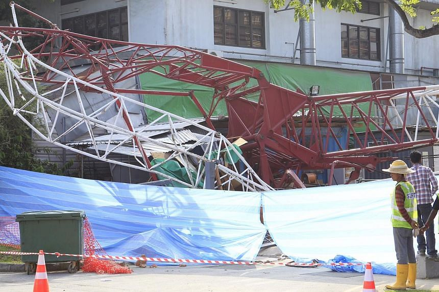 A crane was reduced to twisted metal after it toppled over at a construction site in Hougang on Tuesday, Oct 8, 2013. -- ST PHOTO: KEVIN LIM