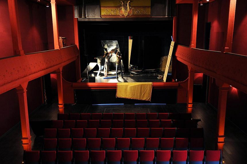 Technicians are at work on Oct 4, 2013, in the projection room of the world's oldest cinema, The Eden Theatre, in La Ciotat, southern France. The world's oldest movie theatre, where the first films of the pioneering Lumiere brothers were screened in