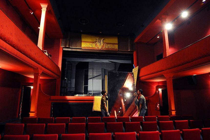 Technicians work on Oct 4, 2013 in the projection room of the world's oldest cinema, The Eden Theatre, in La Ciotat, southern France.-- PHOTO: AFP