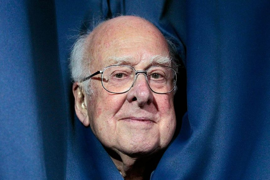 British scientist Professor Peter Higgs poses after addressing a press conference at the University of Edinburgh in Scotland on July 6, 2012. DrHiggs said he was overwhelmed after he and his Belgian colleague Francois Englert were jointly award