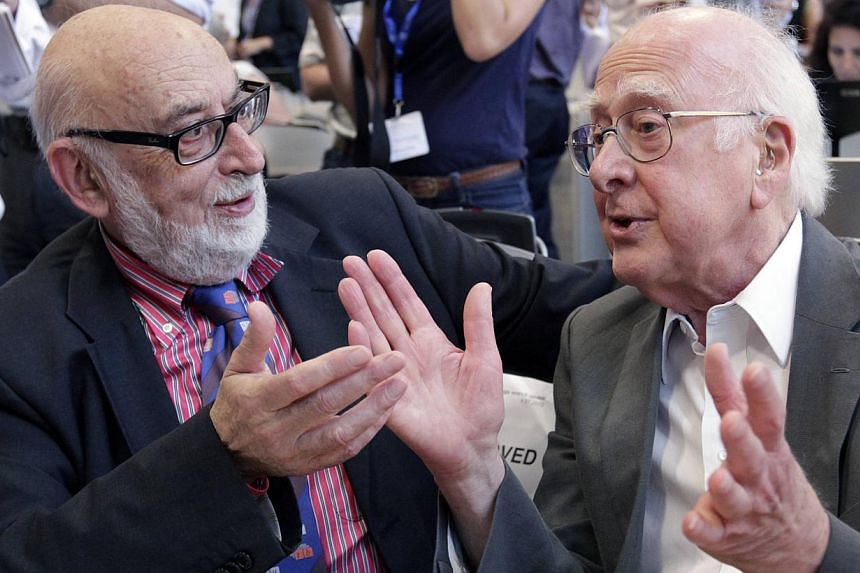 British physicist Peter Higgs (right) talking with Belgium physicist Francois Englert before a news conference on the search for the Higgs boson at the European Organization for Nuclear Research (CERN) in Meyrin near Geneva on July 4, 2012. Mr Higgs