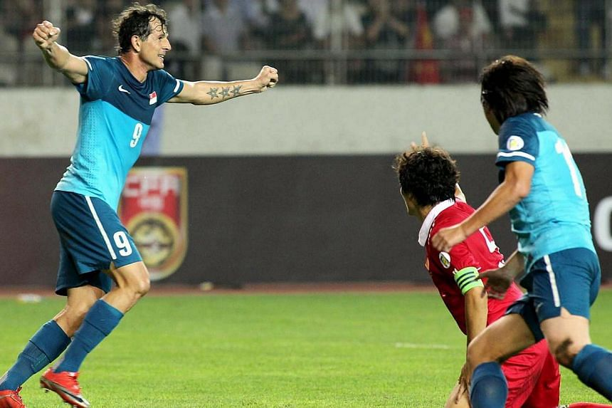 Singapore national player Aleksander Duric celebrates his goal during the World Cup Qualifier football match against China held at the Tuodaong stadium in Kunming, China on Sept 2, 2011. Duric is among the football favourites set to thrill crowds dur