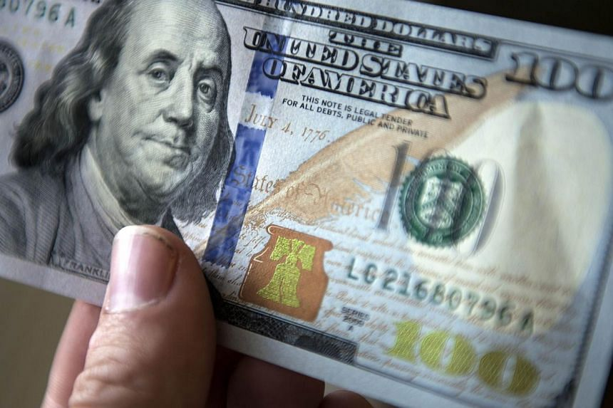 A view of a the new 2009 series $100 bill Oct 4, 2013 in Washington, DC. The United States launches on Tuesday a new US$100 bill that comes with, for the iconic greenback, a new touch of colour, as well as special features to foil counterfeiters. --