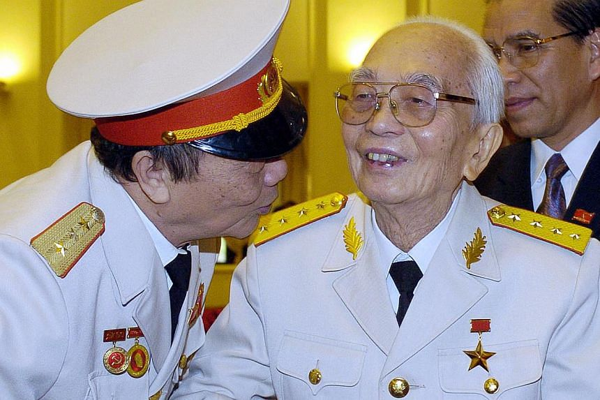 Hanoi shows retired legendary Vietnamese General Vo Nguyen Giap (centre), then 94 years old, greeted by an unidentified general as he arrives to attend a meeting to mark the 60th anniversary of the foundation of Vietnamese armed forces on Dec 20, 200