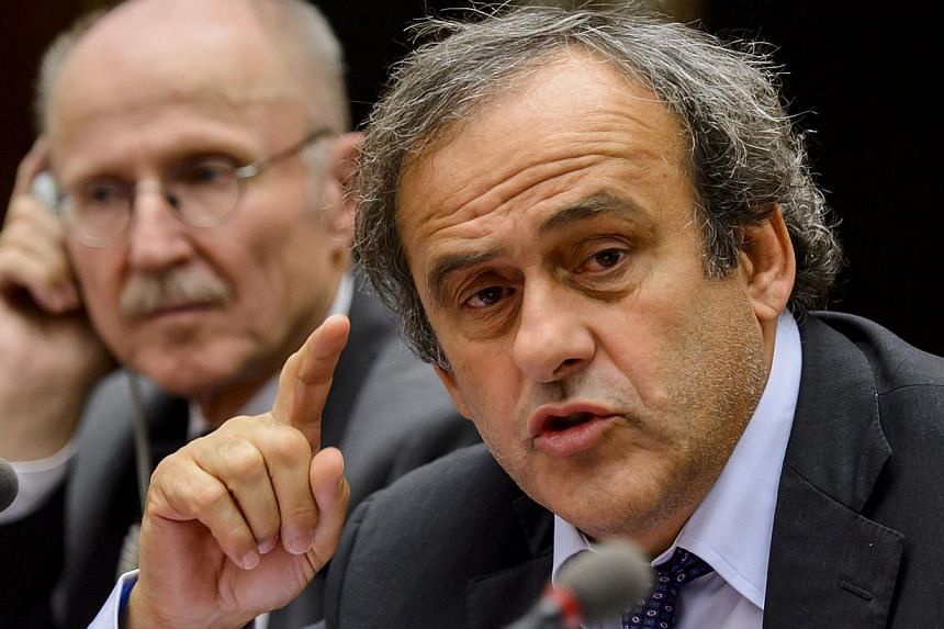 Uefa president French Michel Platini (right) gestures next to United Nations (UN) Special Adviser on Sport for Development and Peace, Wilfried Lemke of Germany, during a working group meeting on racism and football on October 7, 2013 at the United Na