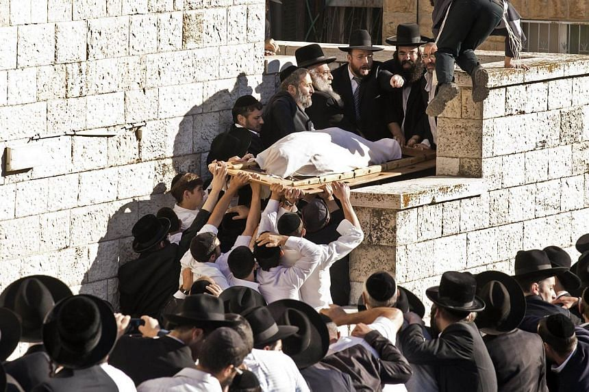 Jewish mourners attend the funeral of Rabbi Ovadia Yosef, the spiritual leader of Israel's Sephardic Jewish community and the ultra-Orthodox Shas party, in Jerusalem's ultra-Orthodox Sanhedria district on Oct 7, 2013. Rabbi Yosef died on Monday at th