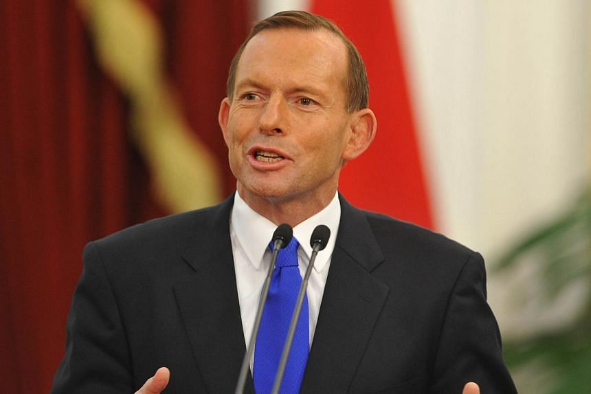 "Australia's Prime Minister Tony Abbott speaks to journalists during a joint statement with Indonesia's President Susilo Bambang Yudhoyono at the presidential palace in Jakarta on Sept 30, 2013. Organisers of the ""Ernie"" awards for sexism on Oct 8, 20"