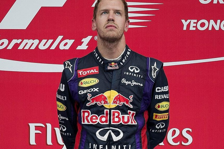 Red Bull driver Sebastian Vettel of Germany listen to the German national anthem after winning the Formula One Korean Grand Prix in Yeongam on Oct 6, 2013. Sebastian Vettel has endured boos and his dominance has been called boring but he stands on th