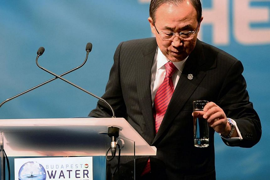Secretary General of the United Nations Ban Ki-moon takes a glass of water as he makes his opening speech for 'Budapest Water Summit 2013' on the stage of the Millenaris Cultural Center in Budapest on October 8, 2013 during the beginning of the summi