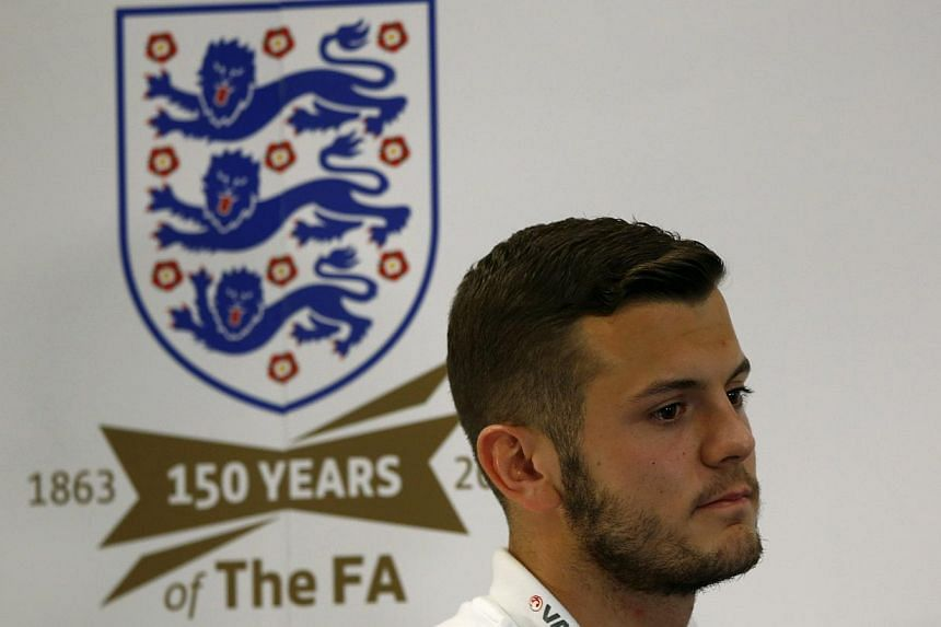 England's Jack Wilshere leaves after a news conference, ahead of their 2014 World Cup qualifying soccer match against Montenegro at the St George's Park training complex near Burton upon Trent, on Oct 8, 2013. England midfielder Jack Wilshere says he