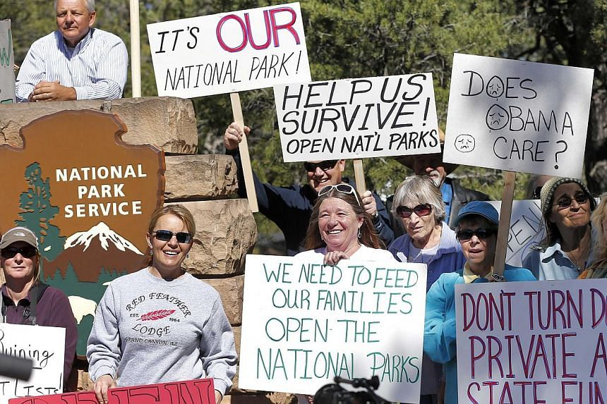 Government shutdown protesters gather at the Grand Canyon National Park entrance, Tuesday, Oct 8, 2013, in Tusayan, Arizona. Americans are fed up with the political deadlock in Washington and frustrated with how the federal government shutdown is int